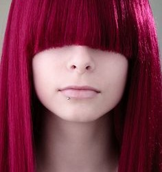 Pale skin looks great with magenta & red hair.